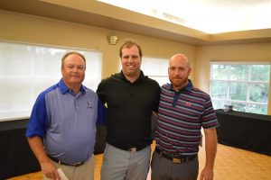 Bill Minkhorst (middle) wins the Flagstick.com Players Tour PGA of Ottawa Spring Open. He is congratulated by Board members Colin Orr (Left) and Bill Keating (Right)